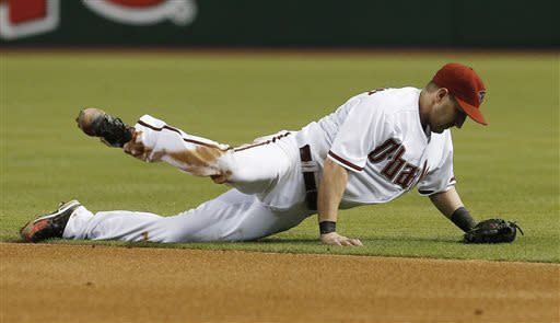 Arizona Diamondbacks' Willie Bloomquist makes a diving catch on a line drive hit by San Francisco Giants' Gregor Blanco during the fifth inning in a baseball game Friday, June 7, 2013, in Phoenix. (AP Photo/Ross D. Franklin)