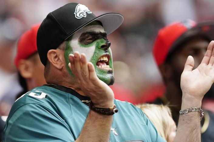 A Philadelphia Eagles fan cheers during the first half of an NFL football game against the Atlanta Falcons, Sunday, Sept. 12, 2021, in Atlanta. (AP Photo/John Bazemore)