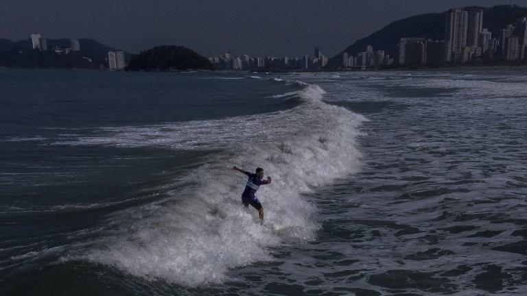 Brazilian surfer Miguel Almeida, who has vision problems, rides a wave during a training in the Adapted Surf School at Gonzaga Beach, in Santos, Sao Paulo, Brazil on June 2, 2021