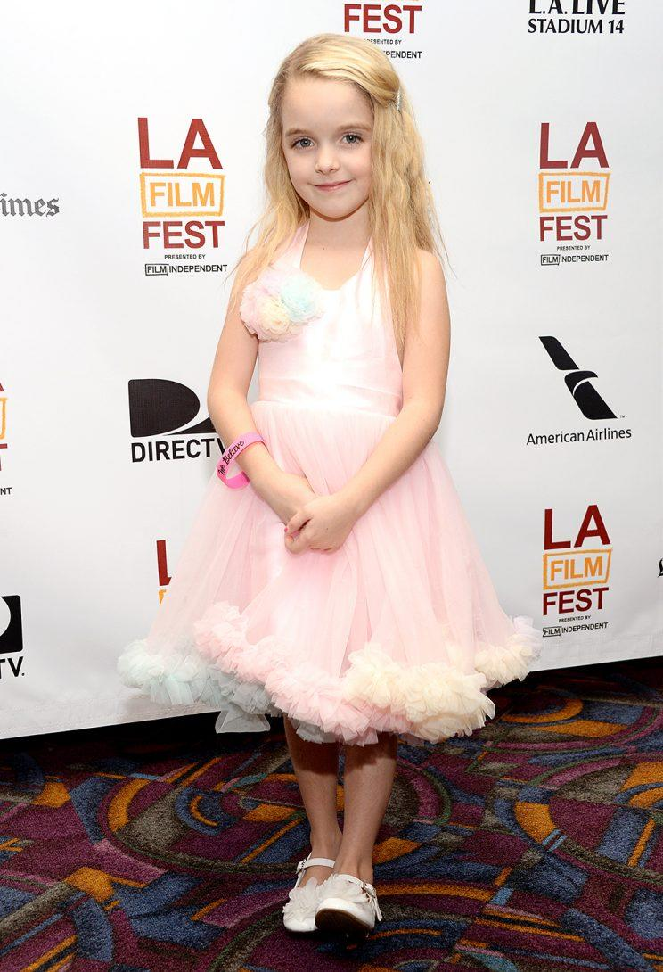 Mckenna Grace attends the 2013 Los Angeles Film Festival Premiere of Goodbye World.