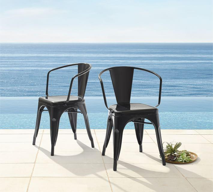 """<p><strong>Pottery Barn</strong></p><p>potterybarn.com</p><p><strong>$93.00</strong></p><p><a href=""""https://go.redirectingat.com?id=74968X1596630&url=https%3A%2F%2Fwww.potterybarn.com%2Fproducts%2Ftavern-outdoor-stacking-bistro-chair-black%2F&sref=https%3A%2F%2Fwww.goodhousekeeping.com%2Fhome-products%2Fg32743125%2Fbest-patio-chairs%2F"""" rel=""""nofollow noopener"""" target=""""_blank"""" data-ylk=""""slk:Shop Now"""" class=""""link rapid-noclick-resp"""">Shop Now</a></p><p>Take up less visual space with this durable steel chair, featuring an open back. </p>"""