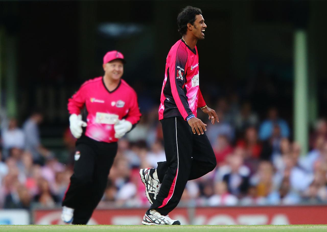 SYDNEY, AUSTRALIA - JANUARY 09:  Sachithra Senanayake of the Sixers celebrates after claiming the wicket of Daniel Harris of the Renegades during the Big Bash League match between the Sydney Sixers and the Melbourne Renegades at SCG on January 9, 2013 in Sydney, Australia.  (Photo by Brendon Thorne/Getty Images)