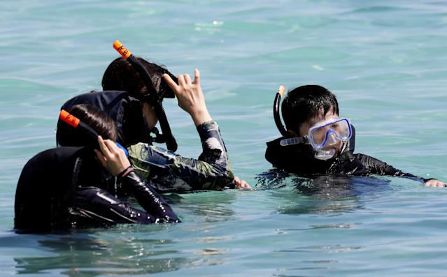 <p>Tourists snorkel on the waters off Tumon beach on the island of Guam, a U.S. Pacific Territory, August 11, 2017. (Erik De Castro/Reuters) </p>