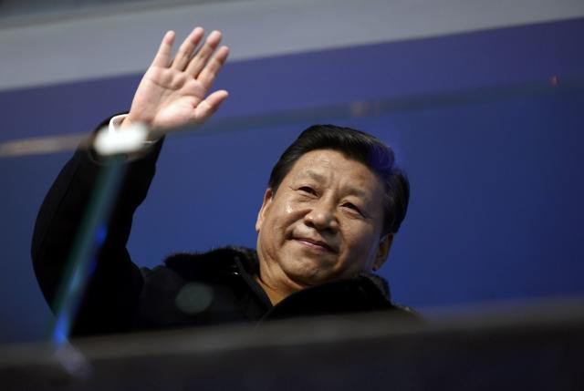 China's President Xi Jinping waves from the presidential tribune at the opening ceremony of the 2014 Winter Olympics in Sochi, February 7, 2014. REUTERS/Lionel Bonaventure/Pool (RUSSIA - Tags: OLYMPICS SPORT POLITICS)