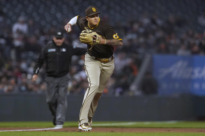 San Diego Padres third baseman Manny Machado throws out San Francisco Giants' Darin Ruf at first base during the second inning of a baseball game in San Francisco, Monday, Sept. 13, 2021. (AP Photo/Jeff Chiu)