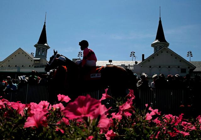 LOUISVILLE, KY - MAY 03: A horse and jockey walk past the twin spires prior to the 140th running of the Kentucky Derby at Churchill Downs on May 3, 2014 in Louisville, Kentucky. (Photo by Kevin C. Cox/Getty Images)