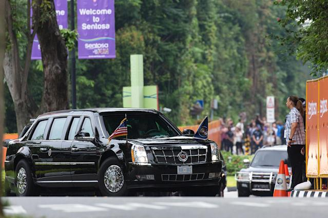 <p>President Donald Trump's motorcade arrives at Capella Hotel in Sentosa ahead of North Korean leader Kim Jong-un's motorcade on June 12, 2018 in Singapore. U.S. President Trump and North Korean leader Kim Jong-un held the historic meeting between leaders of both countries on Tuesday morning in Singapore, carrying hopes to end decades of hostility and the threat of North Korea's nuclear programme. (Photo: Ore Huiying/Getty Images) </p>