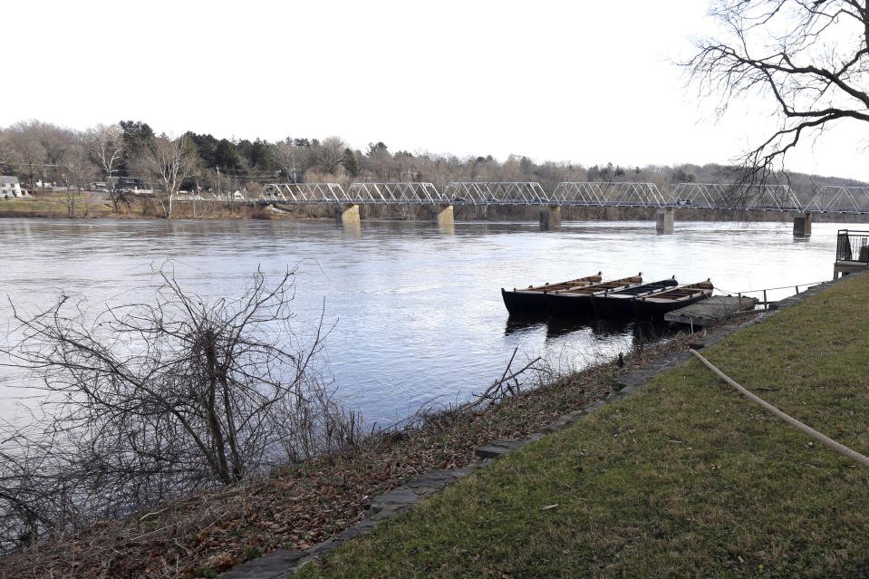 FILE - This Tuesday Dec. 25, 2018 file photo shows the Delaware River at Washington Crossing, Pa. On Thursday, Feb. 25, 2021, the Delaware River Basin Commission, a regulatory agency that's responsible for the water supply of more than 13 million people in four states voted to permanently ban natural gas drilling and fracking in the watershed. (AP Photo/Jacqueline Larma)