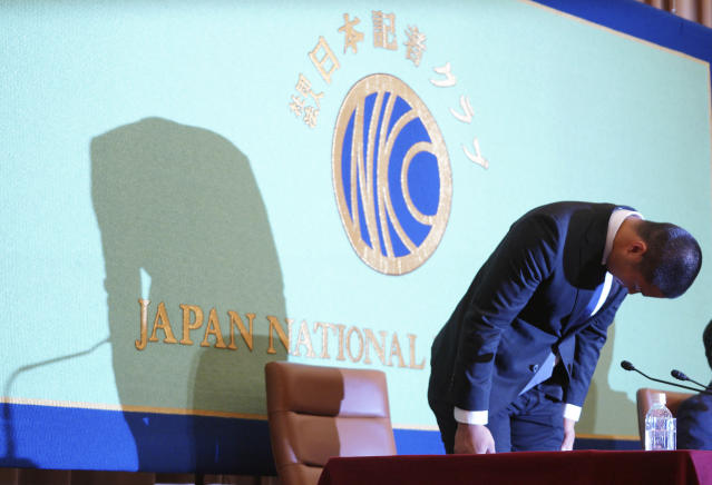 Nihon University's American football player Taisuke Miyagawa bows at a news conference Tuesday, May 22, 2018, in Tokyo. The Japanese college football player has apologized for intentionally injuring the quarterback of an opposing team, an incident that has riveted Japan for several weeks. In a news conference broadcast live across Japan, Miyagawa bowed deeply and said his coach had told him to do it - but he said he should have been stronger and refused the coaching order. (AP Photo/Eugene Hoshiko)