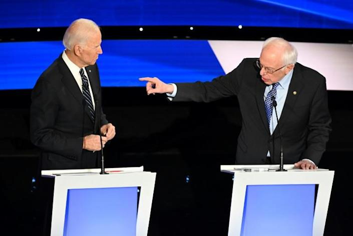 US former vice president Joe Biden (L) and liberal Senator Bernie Sanders were two of the six candidates who clashed during the final Democratic presidential debate before Iowa begins the voting process on February 3, 2020 (AFP Photo/Robyn Beck)
