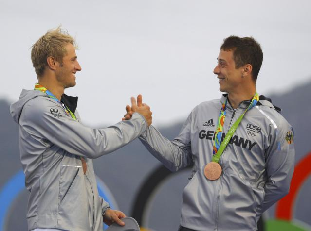 2016 Rio Olympics - Sailing - Victory Ceremony - Men's Skiff - 49er Victory Ceremony - Marina de Gloria - Rio de Janeiro, Brazil -18/08/2016. Erik Heil (GER) of Germany and Thomas Ploessel (GER) of Germany celebrate bronze medal. REUTERS/Brian Snyder FOR EDITORIAL USE ONLY. NOT FOR SALE FOR MARKETING OR ADVERTISING CAMPAIGNS.