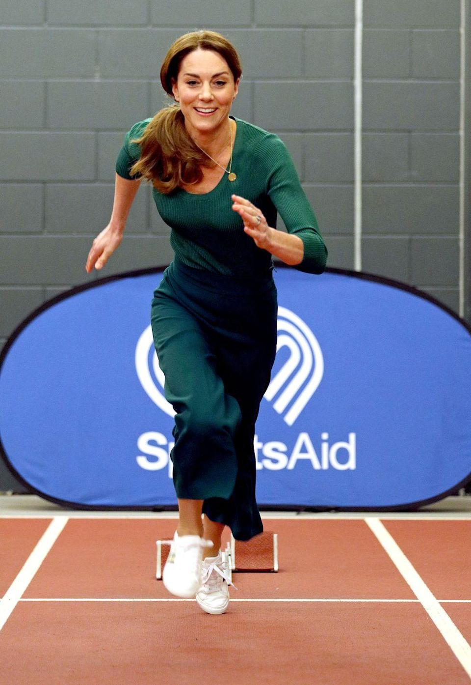 """<p>The Duchess is on the run! Kate wore an <a href=""""https://www.townandcountrymag.com/society/tradition/a31112240/kate-middleton-green-athleisure-look-sportsaid-photos/"""" rel=""""nofollow noopener"""" target=""""_blank"""" data-ylk=""""slk:all-green athleisure look"""" class=""""link rapid-noclick-resp"""">all-green athleisure look</a> to a SportsAid event at the London Stadium. She paired the outfit with <a href=""""https://www.womenshealthmag.com/uk/gym-wear/a36002134/kate-middleton-marks-spencer-trainers-new-colours/"""" rel=""""nofollow noopener"""" target=""""_blank"""" data-ylk=""""slk:Marks & Spencer striped trainers"""" class=""""link rapid-noclick-resp"""">Marks & Spencer striped trainers</a> and tried her hand at both racing on the track and taekwondo. </p>"""