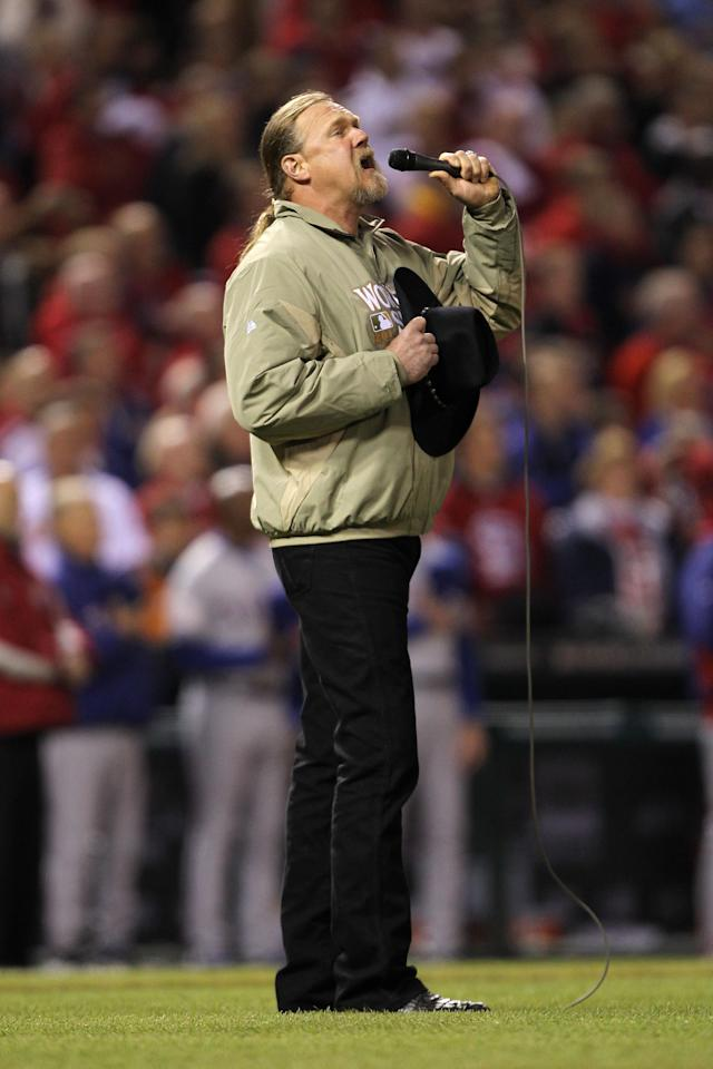 ST LOUIS, MO - OCTOBER 20: Country star Trace Atkins sings the national anthem prior to Game Two of the MLB World Series between the Texas Rangers and the St. Louis Cardinals at Busch Stadium on October 20, 2011 in St Louis, Missouri. (Photo by Ezra Shaw/Getty Images)