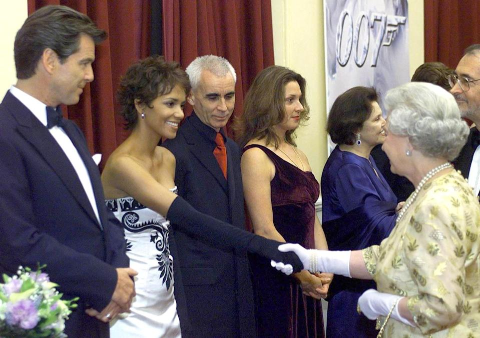 <p>Looks like Halle Berry got the elbow-length glove note. She pulled out all the stops when planning her meet-the-Queen outfit: Silk, diamonds, embroidery, the works.</p>