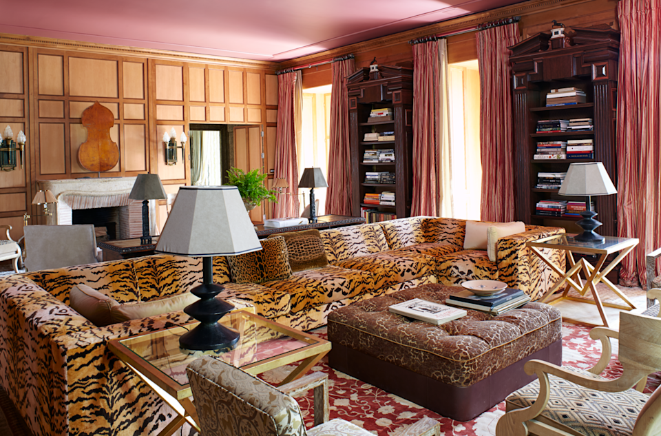 """<p>A feast of patterns and antiques are mingled throughout the media and reading room of designer <a href=""""https://www.molyneuxstudio.com/"""" rel=""""nofollow noopener"""" target=""""_blank"""" data-ylk=""""slk:Juan Pablo Molyneux's"""" class=""""link rapid-noclick-resp"""">Juan Pablo Molyneux's</a> Château de Pouy-sur-Vannes. A pair of Giacometti lamps flank a custom sectional upholstered in a <a href=""""https://www.luigi-bevilacqua.com/en/"""" rel=""""nofollow noopener"""" target=""""_blank"""" data-ylk=""""slk:Luigi Bevilacqua"""" class=""""link rapid-noclick-resp"""">Luigi Bevilacqua</a> tiger velvet.</p>"""