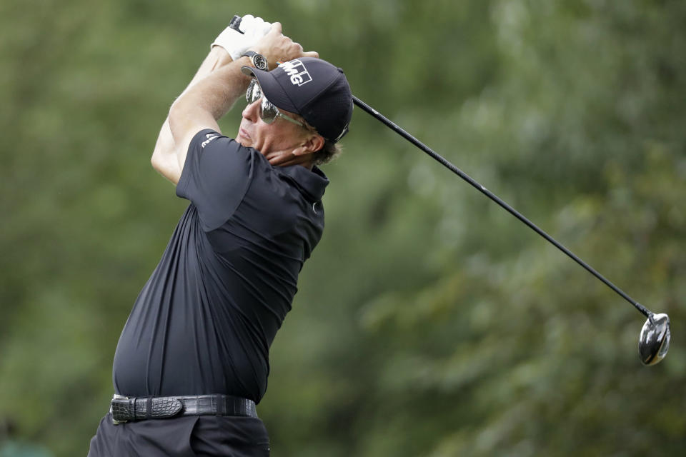 Phil Mickelson watches his tee shot on the second hole during the final round of the World Golf Championship-FedEx St. Jude Invitational Sunday, Aug. 2, 2020, in Memphis, Tenn. (AP Photo/Mark Humphrey)