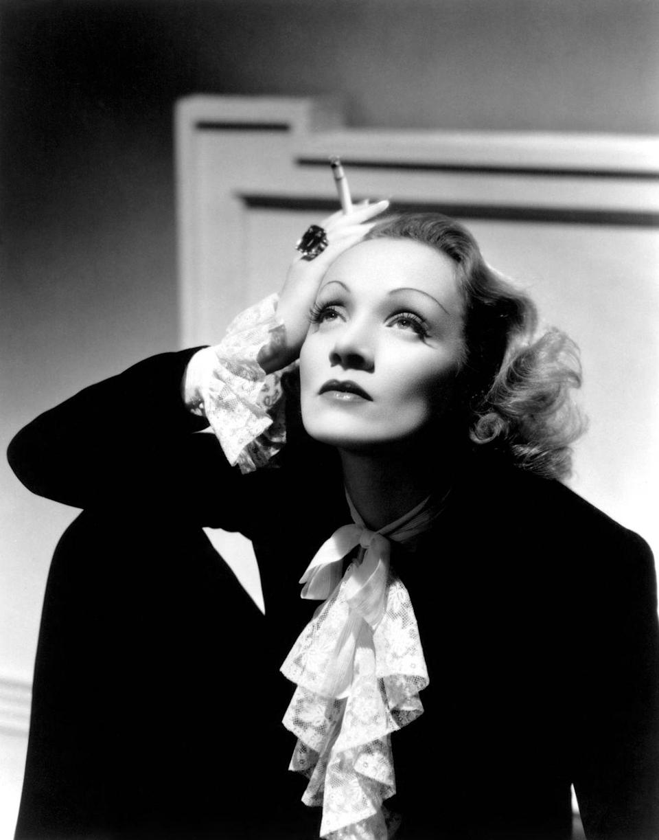 <p>Here, a classic suit and neck-tie blouse is given a modern spin thanks to Dietrich's singular style. Take note: Any traditional ensemble can benefit from an oversized cocktail ring. <br></p>