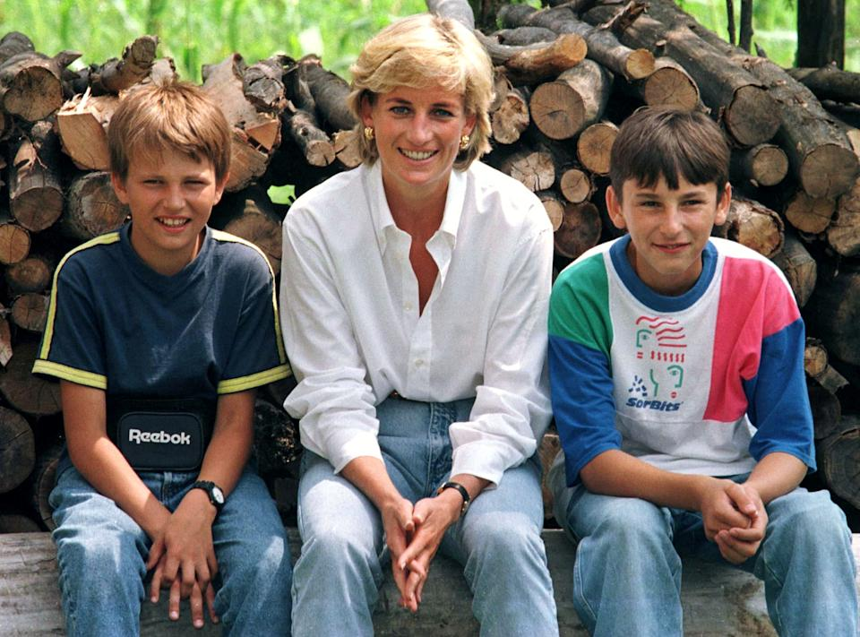 Diana, Princess of Wales sits with mine victim, Malic Bradoric, 14, (R) who is a Muslim, and fellow mine victim Zarco Beric, 12, a Serb during Diana's visit to Bosnia and Herzegovina August 9. Diana is in Bosnia and Herzegovina until Sunday.