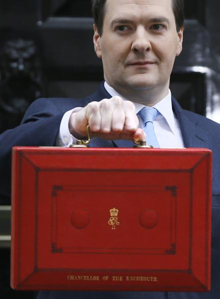 Britain's Chancellor George Osborne holds up his briefcase for the media as he leaves Downing Street to attend Parliament in London, Wednesday, March 20, 2013. Later Wednesday Osborne will deliver the Spring Budget Statement in Parliament. (AP Photo/Kirsty Wigglesworth)