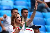 <p>A female fan of Iran waves prior to the 2018 FIFA World Cup Russia group B match between Morocco and Iran at Saint Petersburg Stadium on June 15, 2018 in Saint Petersburg, Russia. (Photo by Robbie Jay Barratt – AMA/Getty Images) </p>