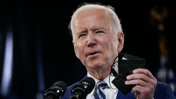 PHOTO: President Joe Biden holds up a face mask as he delivers remarks on the COVID-19 response and the state of vaccinations on March 29, 2021. (Drew Angerer/Getty Images)