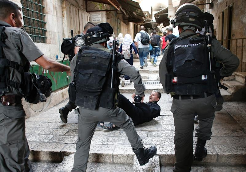 A Palestinian lies in an alley leading to the Al-Aqsa mosque compound in Jerusalem's Old City after scuffles with Israeli riot police on September 14, 2015
