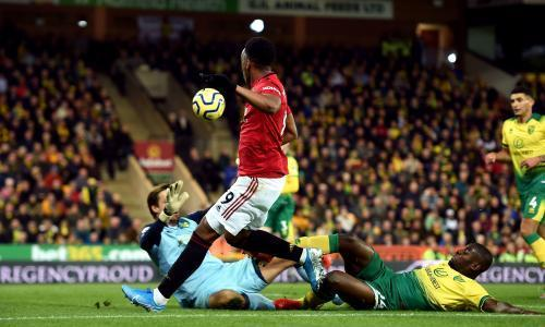"""You wait almost seven months for an away victory and then two come along in the space of four days. Manchester United finally recorded a first Premier League win on the road since Ole Gunnar Solskjær was appointed permanently thanks to goals from Scott McTominay, Marcus Rashford and Anthony Martial, although it could have been even worse for Norwich had it not been for the heroics of Tim Krul. The Dutchman's two penalty saves in the first half to deny first Rashford and then Martial after VAR had overturned the referee Stuart Attwell's original decisions kept the hosts in the game longer than they probably deserved, in truth, such was the disarray of their defence at times. But a clinical away performance ensured United rounded off a promising week in style, even if Solskjær will know that much tougher challenges surely lie ahead. """"It's been too long but it's great to have ended that run. If we play like we did today, we can beat anyone,"""" said Solskjær, who insisted both penalties should have been retaken because Krul was off his line but was otherwise full of praise for his attacking players. """"We've missed Anthony for the last two months and his partnership with Marcus is going to grow and grow."""" After his winning goal against Partizan Belgrade in Thursday's Europa League tie, Martial's first league start since the home defeat to Crystal Palace at the end of August had allowed Solskjær to abandon the formation that served him so well in Serbia and against Liverpool last week. The Frenchman began as the lone striker in a 4-2-3-1 system that had Rashford and Daniel James on the flanks. The Norwich manager, Daniel Farke, was able to name the same side that had picked up a first clean sheet of the season at Bournemouth last week, a result that ended a run of three successive defeats since the surprise win over Manchester City. Their prospects of becoming the first promoted side to beat both Manchester clubs in the same season since Wolves and Portsmouth in 2004 seemed """