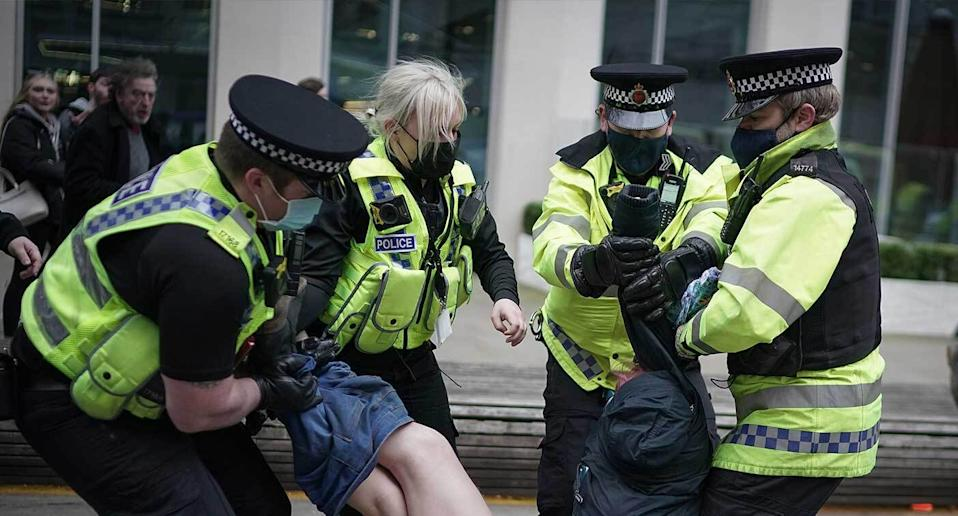 A woman's trousers were pulled down as she was arrested by officers at a