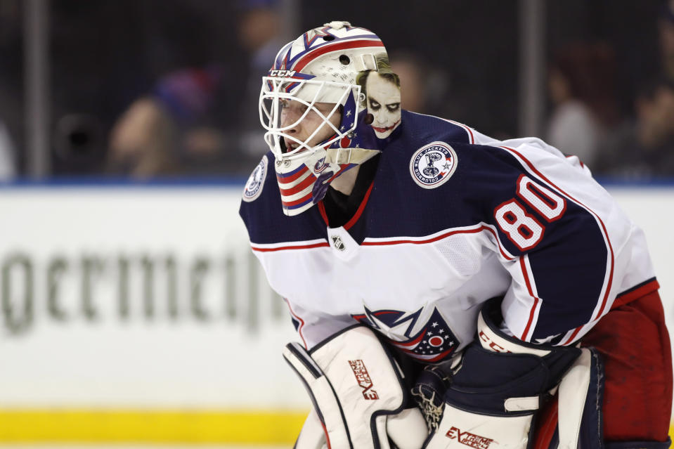 THIS CORRECTS THAT KIVLENIEKS DIED OF CHEST TRAUMA FROM AN ERRANT FIREWORKS MORTAR BLAST AND NOT A SUBSEQUENT FALL AS AUTHORITIES PREVIOUSLY REPORTED - FILE - Columbus Blue Jackets goaltender Matiss Kivlenieks (80) is shown during the second period of an NHL hockey game in New York, in this Sunday, Jan. 19, 2020, file photo. The Columbus Blue Jackets and Latvian Hockey Federation said Monday, July 5, 2021, that 24-year-old goaltender Matiss Kivlenieks has died. A medical examiner in Michigan says an autopsy has determined that Columbus Blue Jackets goaltender Matiss Kivlenieks died of chest trauma from an errant fireworks mortar blast, and not a fall as authorities previously reported. Police in Novi, Michigan, said the mortar-style firework tilted slightly and started to fire toward people nearby Sunday night, July 4. (AP Photo/Kathy Willens, File)