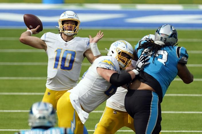 Los Angeles Chargers quarterback Justin Herbert (10) throws against the Carolina Panthers.