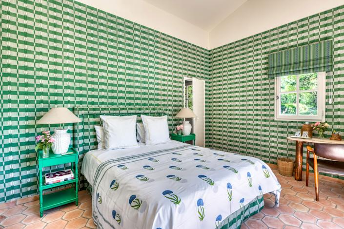"<div class=""caption""> In the guesthouse, named the Orangerie, the wall fabrics are from <a href=""https://www.casalopez.com/en/"" rel=""nofollow noopener"" target=""_blank"" data-ylk=""slk:Casa Lopez"" class=""link rapid-noclick-resp"">Casa Lopez</a> as are the bedside tables. The lights are from the Avignon flea market and the Danish desk from <a href=""https://www.christies.com/"" rel=""nofollow noopener"" target=""_blank"" data-ylk=""slk:Christie's"" class=""link rapid-noclick-resp"">Christie's</a>. The bedcover is from <a href=""https://simrane.com/en/"" rel=""nofollow noopener"" target=""_blank"" data-ylk=""slk:Simrane"" class=""link rapid-noclick-resp"">Simrane</a> in Paris. </div>"