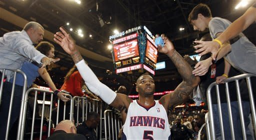 Atlanta Hawks forward Josh Smith (5) celebrates with fans as he leaves the court after defeating Oklahoma City Thunder 97-90 in an NBA basketball game Saturday, March 3, 2012, in Atlanta. Smith scored 30 points. (AP Photo/John Bazemore)