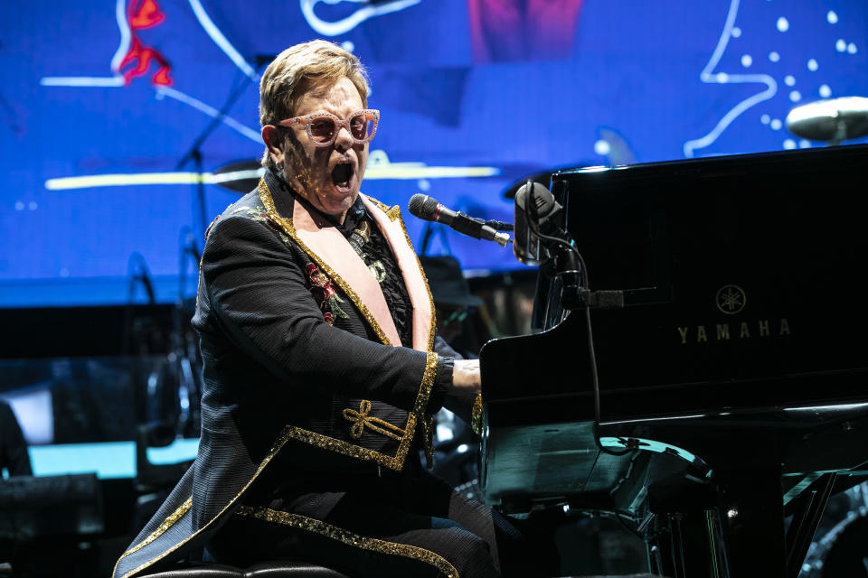 """CHARLOTTE, NORTH CAROLINA - NOVEMBER 06: Elton John performs during the """"Farewell Yellow Brick Road"""" Tour at Spectrum Center  on November 06, 2019 in Charlotte, North Carolina. (Photo by Jeff Hahne/Getty Images)"""