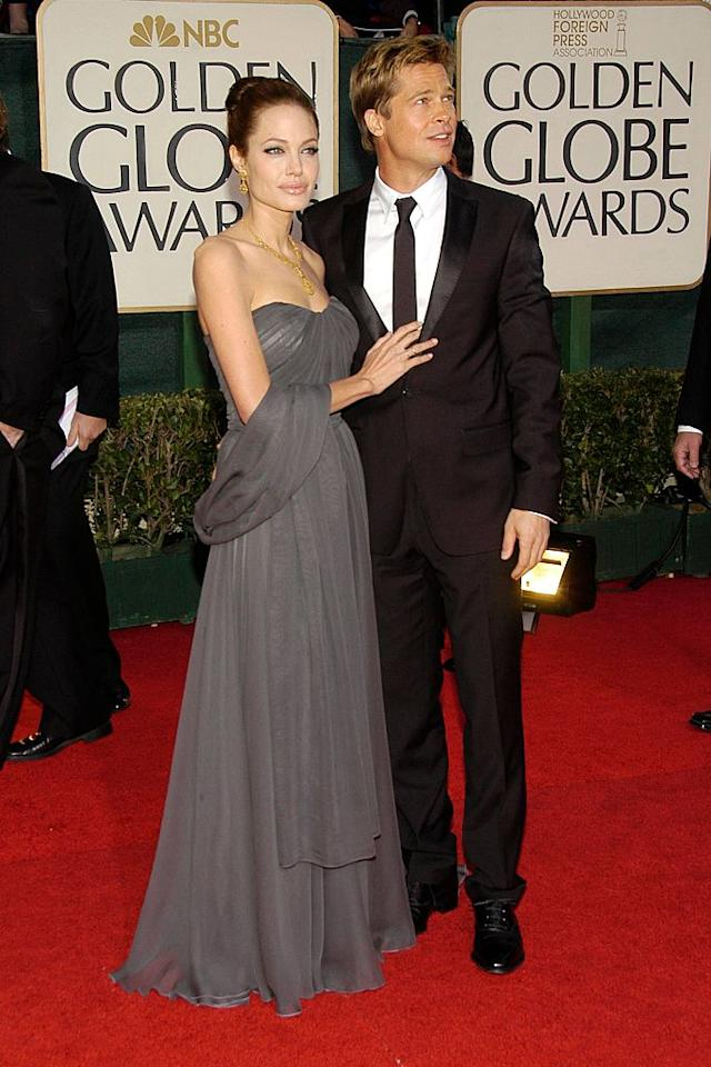 <p>Brad Pitt and Angelina Jolie were the image of togetherness, before things got all ugly with their split and custody battle. (Photo: Getty Images) </p>