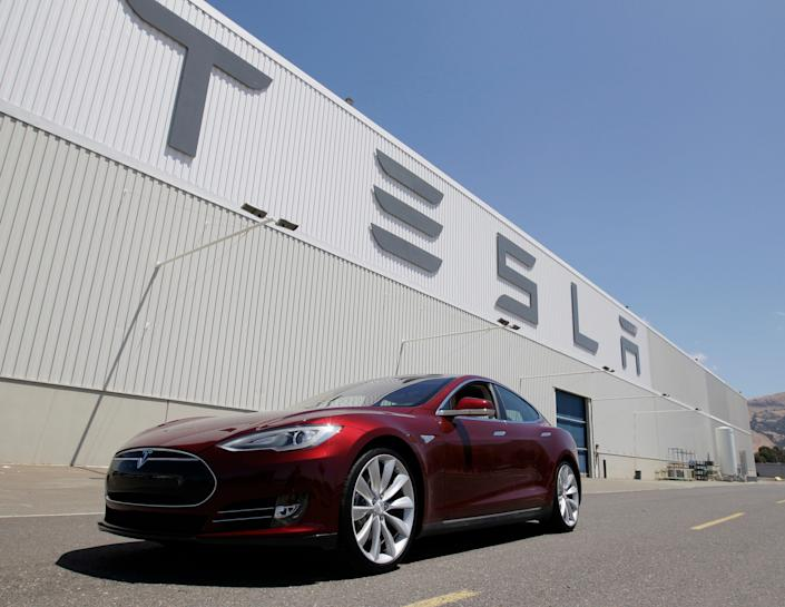 A Tesla Model S is parked in front of the carmaker's Fremont, California, factory.