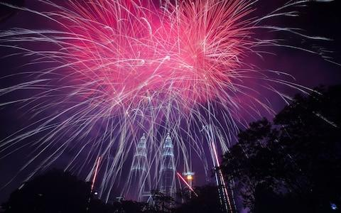 <span>Fireworks explode above Petronas Twin Tower during New Year's Eve celebrations in Kuala Lumpur, Malaysia</span> <span>Credit: Rex </span>