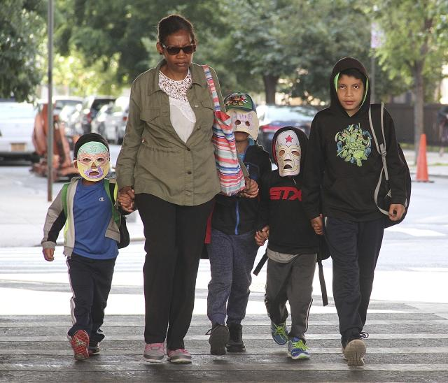<p>Immigrant children separated from parents who were detained at the U.S./Mexico border arrive Cayuga Center, a foster care facility, in East Harlem wearing masks, hats and sunglasses in New York City on June 22, 2018. (Photo: Rainmaker Photo/MediaPunch/IPX/AP) </p>