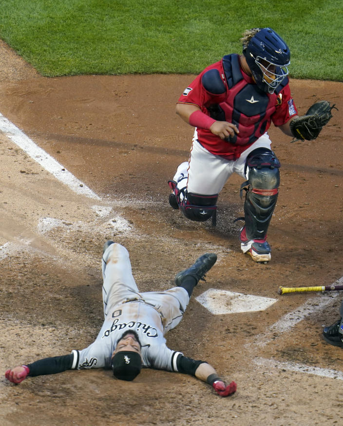 Chicago White Sox's Billy Hamilton, bottom, is tagged out by Minnesota Twins catcher Willians Astudillo while trying to stretch a triple in the fifth inning of a baseball game, Monday, May 17, 2021, in Minneapolis. (AP Photo/Jim Mone)