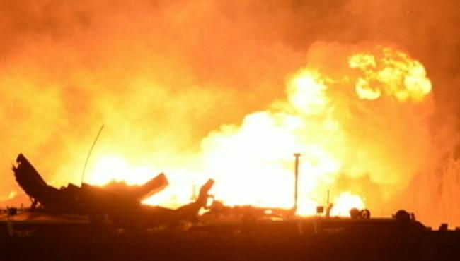 Investigators are trying to find out what caused seven explosions on two fuel barges.