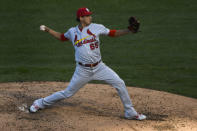 St. Louis Cardinals relief pitcher Giovanny Gallegos delivers during the sixth inning of Game 1 of a baseball doubleheader against the Chicago Cubs, Monday, Aug. 17, 2020, in Chicago. (AP Photo/Matt Marton)