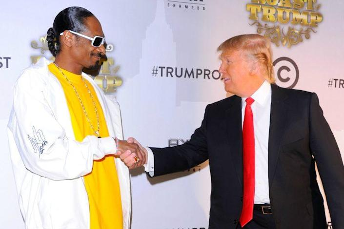 Snoop and Trump shake hands before the Comedy Central Roast of Donald Trump in New York City, March 9, 2011. (Photo by Andrew H. Walker/Getty Images)