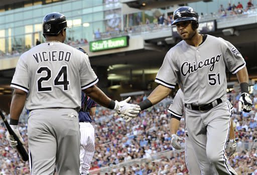 Chicago White Sox's Alex Rios, right, is congratulated by Dayan Viciedo after Rios' two-run home run off Minnesota Twins pitcher Liam Hendriks in the fourth inning of a baseball game, Tuesday, June 26, 2012, in Minneapolis. (AP Photo/Jim Mone)