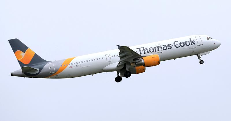 File photo dated 19/05/16 of a Thomas Cook plane taking off. The holiday giant is will open a new boutique hotel this week as it seeks to reassure customers over its finances.
