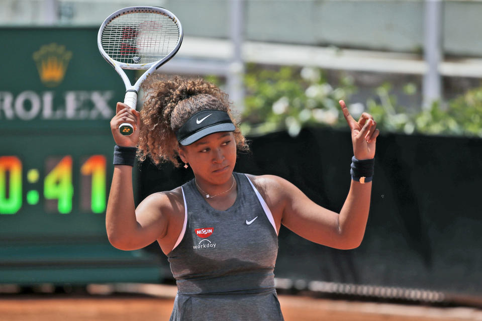 Naomi Osaka of Japan reacts after losing a point against Jessica Pegula of the United States during their match at the Italian Open tennis tournament, in Rome, Wednesday, May 12, 2021. Osaka lost against Pegula 7-6, 6-2. (AP Photo/Alessandra Tarantino)