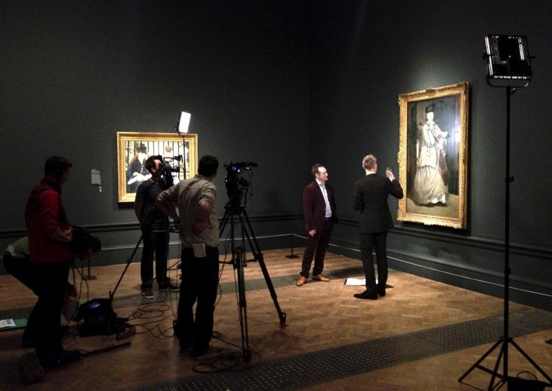 In this Jan. 2013 photo provided by Phil Grabsky Films, a film crew works on a film about an exhibit devoted to the portraiture of Edouard Manet at the Royal Academy of Arts in London. On April 11, BY Experience is launching EXHIBITION, broadcasts of current or just closed art exhibitions from around the world to select movie theaters and performing arts centers in nearly 30 countries. (AP Photo/Phil Grabsky Films)