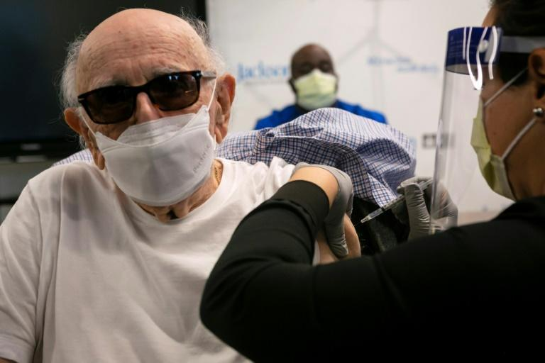 Norman Einspruch, 88, a cardiology patient, receives his first dose of the Pfizer-BioNtech Covid-19 vaccine in Miami, Florida on December 30, 2020