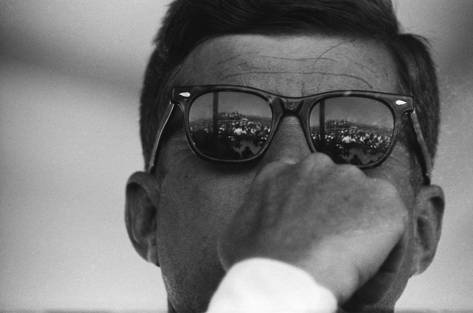 <p>The crowd at the groundbreaking for the Dan Luis Dam is reflected President Kennedy's sunglasses.</p>