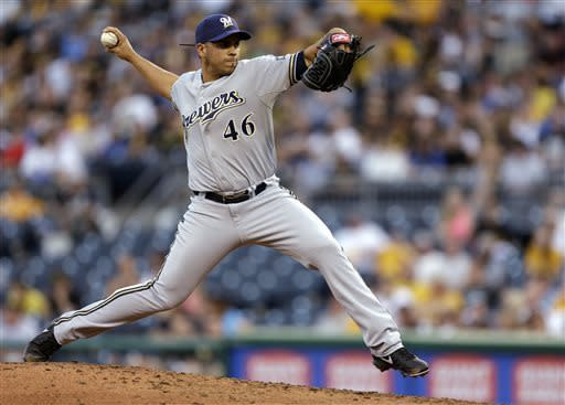 Milwaukee Brewers starting pitcher Hiram Burgos delivers in the third inning of a baseball game against the Pittsburgh Pirates in Pittsburgh, Thursday, May 16, 2013. (AP Photo/Gene J. Puskar)