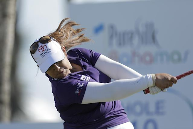 Lizette Salas, from the U.S, tees off during the last day of the LPGA Pure Silk Bahamas at the Classic Ocean Club Golf Course, Paradise Island, Bahamas, Sunday, Jan. 26, 2014.(AP Photo/Tim Aylen)