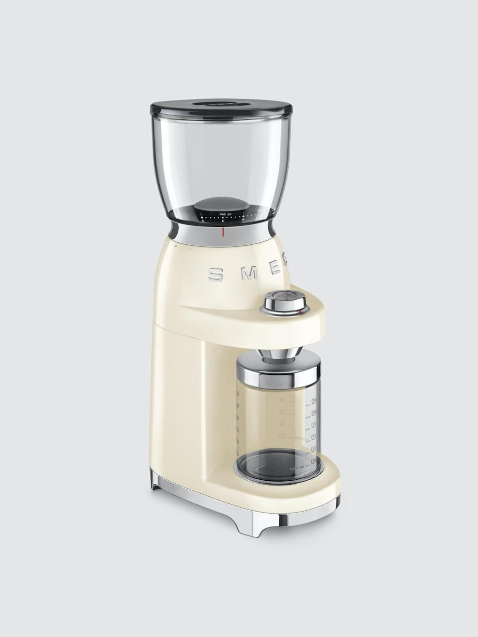 """<h2>Best Quiet Coffee Grinder<br></h2><br><h3>Smeg Coffee Grinder</h3><br>When we think of stunning kitchen accessories and appliances, we think Smeg. Reviewers applaud this grinder not only for its countertop appeal but also for its powerful yet magically quiet grind. <br><br><strong>Blade Type:</strong> Burr<br><br><strong>The Hype</strong>: 4.6 out of 5 stars and 11 reviews on <a href=""""https://www.google.com/shopping/product/16544680367234602904/reviews"""" rel=""""nofollow noopener"""" target=""""_blank"""" data-ylk=""""slk:Google"""" class=""""link rapid-noclick-resp"""">Google</a><br><br><strong>Rise & Grinders say</strong>: """"Love this Smeg grinder. I'm really impressed with the quality and ease of use. It's a very quiet, powerful grinder with a wide selection of settings. I love the pre-measured options and the fact that it doesn't send grounds everywhere. And of course, it's a beautifully designed appliance that looks great on my counter. Love it so far. """"<br><br><em>Shop <a href=""""https://www.verishop.com/smeg/coffee-machine/coffee-grinder/p4798799216663"""" rel=""""nofollow noopener"""" target=""""_blank"""" data-ylk=""""slk:Smeg"""" class=""""link rapid-noclick-resp""""><strong>Smeg</strong></a></em><br><br><strong>SMEG</strong> Coffee Grinder, $, available at <a href=""""https://go.skimresources.com/?id=30283X879131&url=https%3A%2F%2Fshop-links.co%2F1750945987995829009"""" rel=""""nofollow noopener"""" target=""""_blank"""" data-ylk=""""slk:Verishop"""" class=""""link rapid-noclick-resp"""">Verishop</a>"""